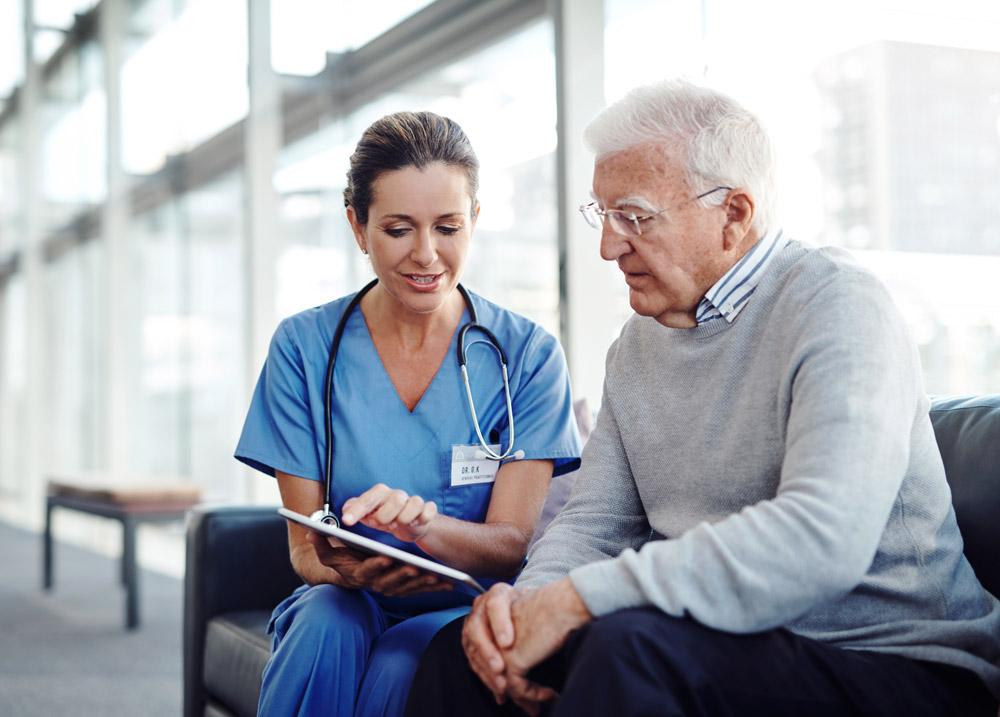 Nurse explaining bowel cancer options