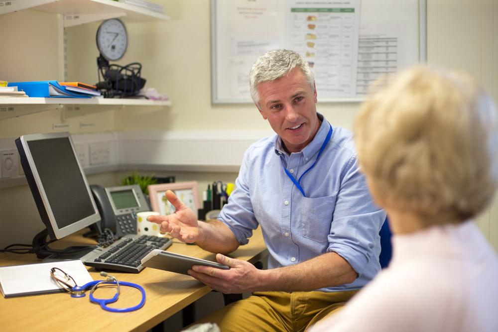 Dr explaining treatment options for bowel cancer
